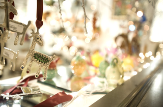 Store front window with Prancer the reindeer ornament hanging in the corner