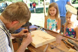 Heritage Festival - children watching a craftsman work with wood