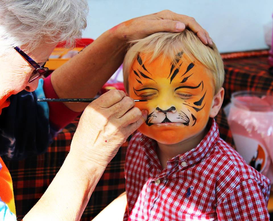Heritage Festival - child having face painted to look like a tiger