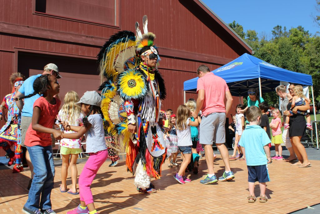 Heritage Festival - native dancer on stage with audience members dancing
