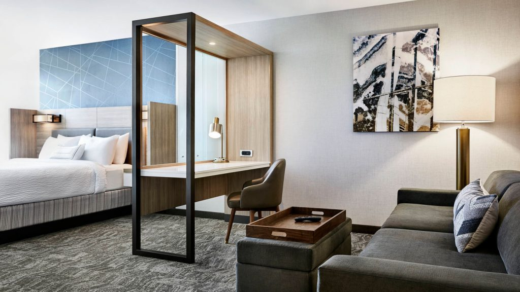 springhill suites bedroom with desk and couch