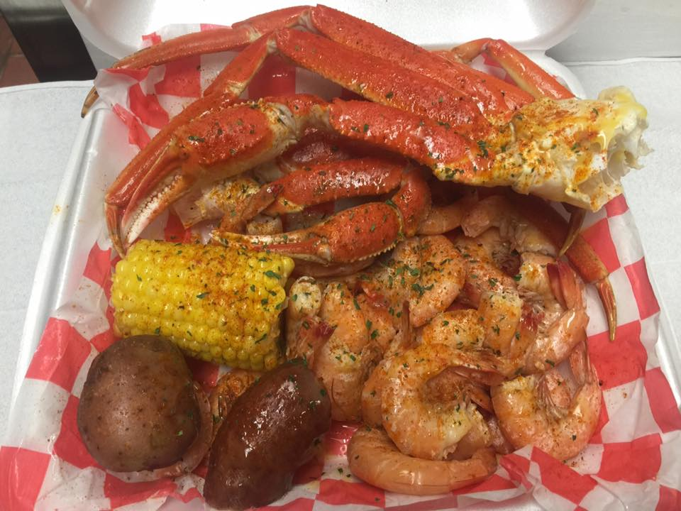 crab legs, shrimp, corn, and potatoes