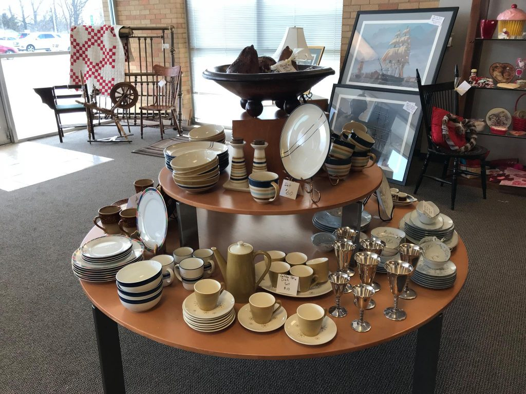 Upscale Resale: table of dishes