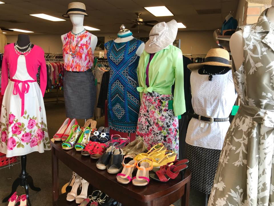 Upscale Resale - mannequins dressed in dresses and skirts